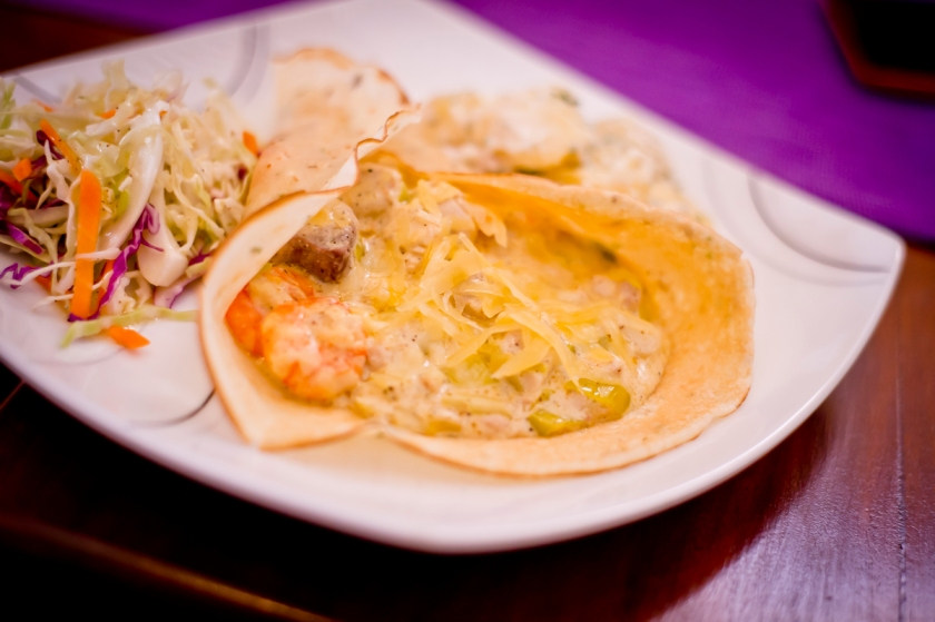 Seafood Crepe with fish and prawns in creamy leeks and mustard sauce.